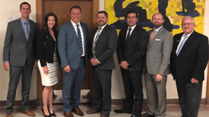 Ivywood's Board members standing with members of Choice Central Office team after presenting Phase II application to a potential authorizing university.