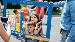 Two students taking a photo with an Ivywood photo frame