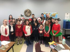 Class wearing red and green for the holidays