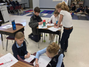 Fifth grade students helped the second grade students color cytoplasm, nuclei, and cell membranes in animal cells and chloroplasts, cell walls, and vacuoles in eukaryotic plant cells with crayons.