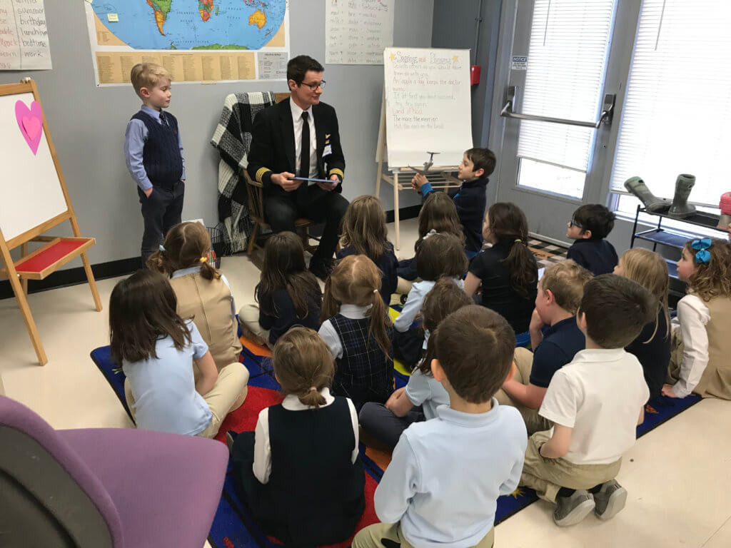 Delta Airlines pilot reading for 1st grade class