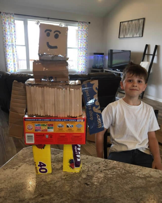 3rd Grade student with Robot made out of recyclables