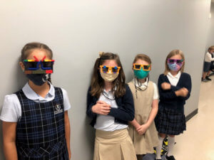 Students wearing sunglasses and masks
