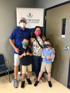 Family wearing masks ready for the first day of school!