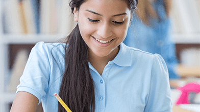 Student writing with a pencil